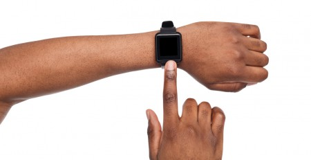 Smartwatch on black male hand, white background cutout. Smartwatch - modern digital gadget with empty display, copy space
